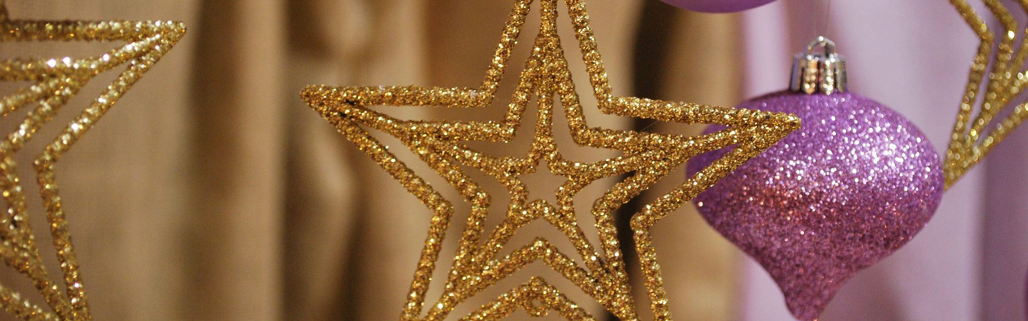 Holiday gold star decoration with lilac tree ornament